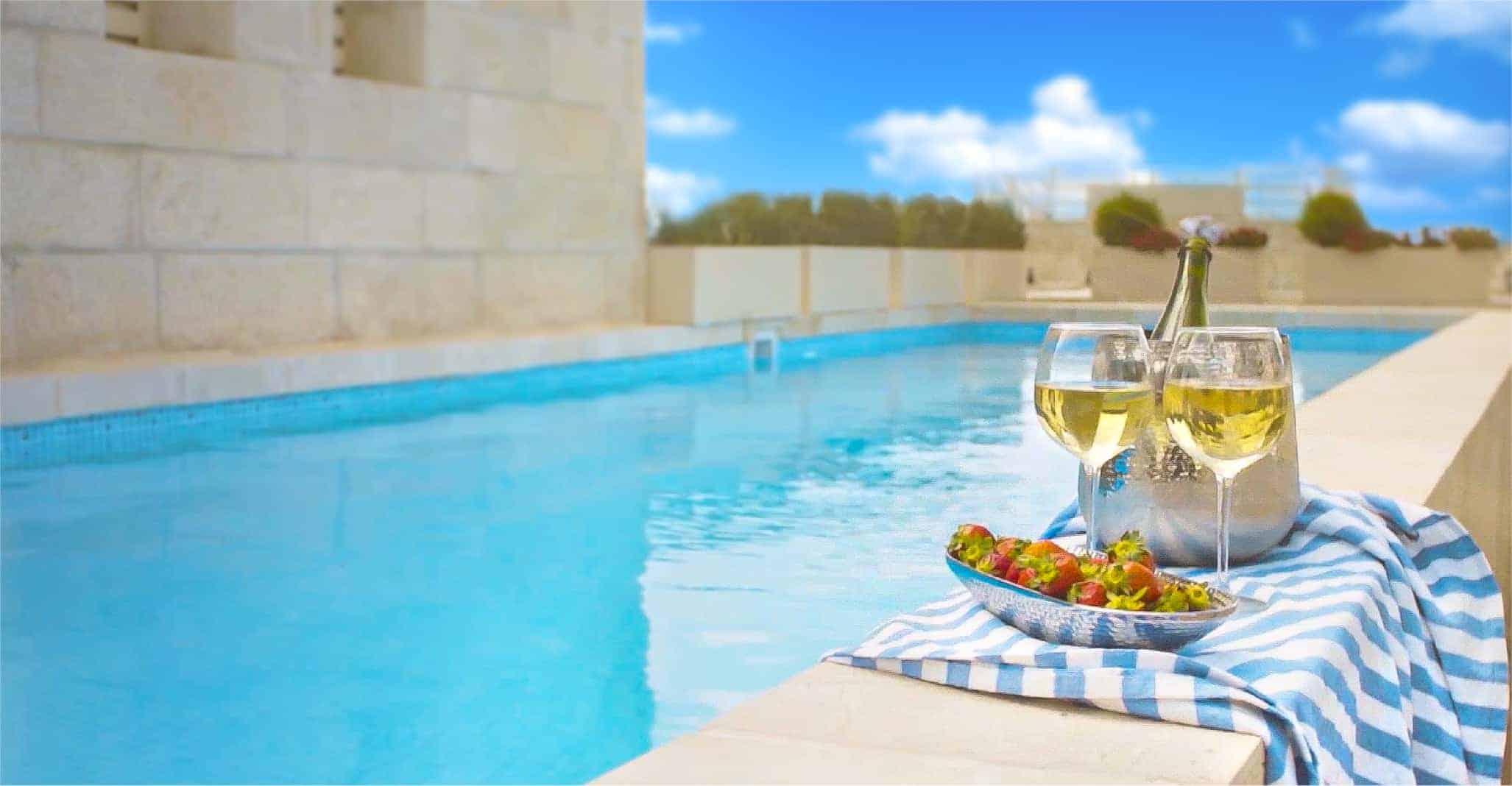 poolside with wine in jerusalem